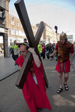 Jesus carries the cross through the streets Royalty Free Stock Image
