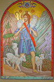 Jesus Carries Lamb. Icon of Jesus Walking with and Carrying a Lamb through a Mountainous Region Stock Image