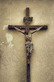Jesus Christ. Old, weathered statue of Jesus Christ against dirty wall Royalty Free Stock Photo