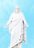 Jesus Christ. A sculpture of Jesus Christ portraying his resurrection with heaven blue blurred background Royalty Free Stock Images