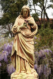Jesus Christ. Statue of Jesus Christ in blooming garden stock image