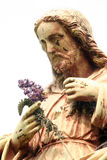 Jesus Christ. Statue of Jesus Christ in blooming garden stock images