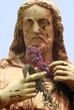 Jesus Christ. Statue of Jesus Christ in blooming garden royalty free stock image