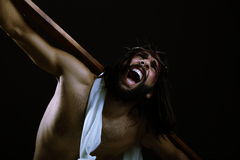 Jesus Christ. Jesus kneeling while his mouth is open screaming Stock Photo