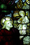 Jesus Christ and the angel with the cup. Stained glass window of Jesus with the angel holding th ecup Royalty Free Stock Photo
