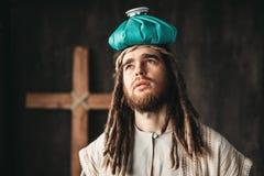 Jesus Christ avec une protection de chauffage sur sa tête Photos libres de droits