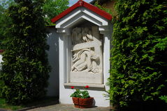 Jesus Christ, bas-relief. Religion, prayer, chcurch service, grave, roses, plant, nature royalty free stock image