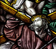 Jesus Christ carrying the cross. Stained glass window of Jesus Christ carrying a wooden cross Royalty Free Stock Photography