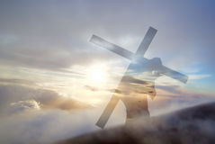 Jesus Christ Carrying Cross up Calvary on Good Friday. Christ carrying cross up Calvary on Good Friday over bright sky royalty free stock photo