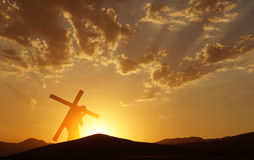 Jesus Christ Carrying Cross up Calvary on Good Friday. Christ carrying cross up Calvary on Good Friday over bright sky royalty free stock images