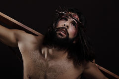 Jesus Christ Close up. With the wooden cross on his back Stock Image
