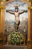 Jesus Christ Cross. Painting in the background Royalty Free Stock Photos