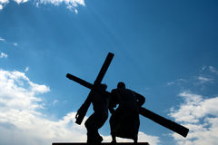 Jesus Christ and Cross. Against a BLUE SKY Stock Image