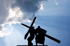 Jesus Christ and Cross. Against a blue sky Royalty Free Stock Image