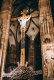 Jesus Christ on cross in Cathedral. Old Jesus Christ statue in Notre-Dame- Cathedral of Strasbourg, France Stock Photos