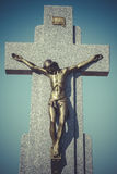 Jesus Christ on the cross in a cemetery Stock Photo