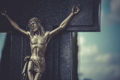 Jesus Christ on the cross in a cemetery Stock Image