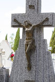 Jesus Christ on the cross in a cemetery Stock Photos