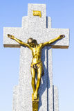 Jesus Christ on the cross in a cemetery Royalty Free Stock Photos