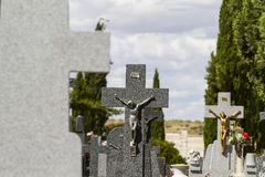 Jesus Christ on the cross in a cemetery Stock Photography