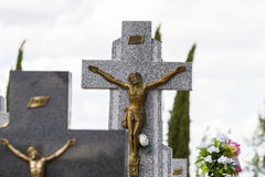 Jesus Christ on the cross in a cemetery Stock Images