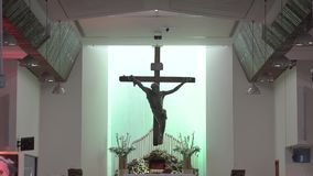 Jesus Christ on the cross in the church. The light of Jesus on the shining cross stock video