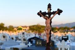 Jesus on Christ cross crucifixion  at graveyard Royalty Free Stock Photos