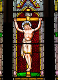 Jesus Christ on the Cross Stained Glass Window. Detail from a stained glass window depicting the crucifixion of Jesus Christ Royalty Free Stock Images