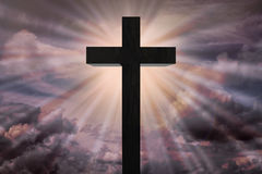 Jesus Christ cross on dramatic sky.Heaven concept Stock Photos