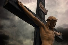 Jesus Christ on cross with dramatic sky. Sky turned black with Jesus Christ sacrificing Stock Images