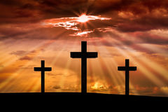 Jesus Christ cross. Easter, Good Friday concept. Jesus Christ cross on a background with dramatic sky, lighting, colorful red, orange sunset, dark clouds Stock Photography