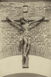 Jesus christ on the cross in front of wall Stock Images