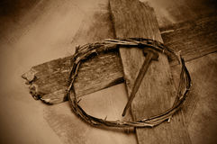 Jesus Christ cross, nail and crown of thorns. Closeup of a representation of the Jesus Christ crown of thorns, cross and nail Stock Photos