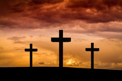 Free Jesus Christ Cross On A Red, Orange Sky With Dramatic Clouds, Dark Sunset Stock Photography - 87385332