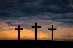Jesus Christ cross. Between two crosses on Golgotha Mountain, on blue, orange, purple sky with dramatic clouds,light,sunset, twilight, dusk. Easter, Crucifixion Royalty Free Stock Image