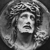 Jesus Christ in a crown of thorns fragment of ancient statue