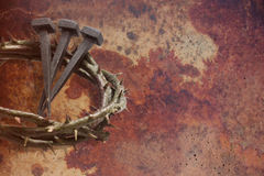 Jesus Christ crown of thorns and nails. Jesus Christ crown of thorns and nails on a grunge background. Focus is on part of the nails Royalty Free Stock Photography