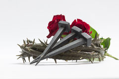 Jesus Christ crown of thorns, nails and two roses. Jesus Christ crown of thorns, nails and two roses on a white background Royalty Free Stock Image