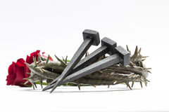 Jesus Christ crown of thorns, nails and two roses. Jesus Christ crown of thorns, nails and two roses on a white background Stock Photos