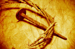 The Jesus Christ crown of thorns with a retro filter effect. A nail and the Jesus Christ crown of thorns, with a retro filter effect Stock Photo