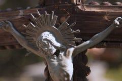 Jesus Christ crucified an ancient sculpture. Details Stock Photo