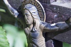 Jesus Christ crucified an ancient wooden sculpture. Details Stock Image