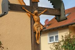 Jesus Christ crucified. An ancient wooden sculpture. Details royalty free stock photo