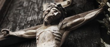 A wooden sculpture of crucified Jesus Christ  styled retro Stock Photography