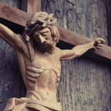 Jesus Christ crucified. Fragment of an ancient wooden sculpture.  stock image