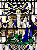 Jesus Christ crucified in stained glass Stock Images