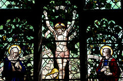 Jesus Christ crucified in stained glass Royalty Free Stock Photos