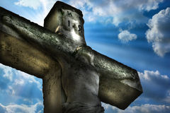 Jesus Christ. Crucifixion Jesus Christ statue on the sky background and natural light. Public sculpture in the cemetery Royalty Free Stock Image