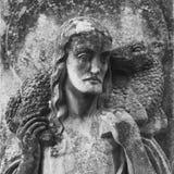 Jesus Christ - de Goede Herder (fragment van oud standbeeld) Royalty-vrije Stock Foto's