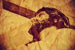 Jesus Christ, der das heilige Kreuz, mit einem Retro- Effekt trägt lizenzfreie stockfotos